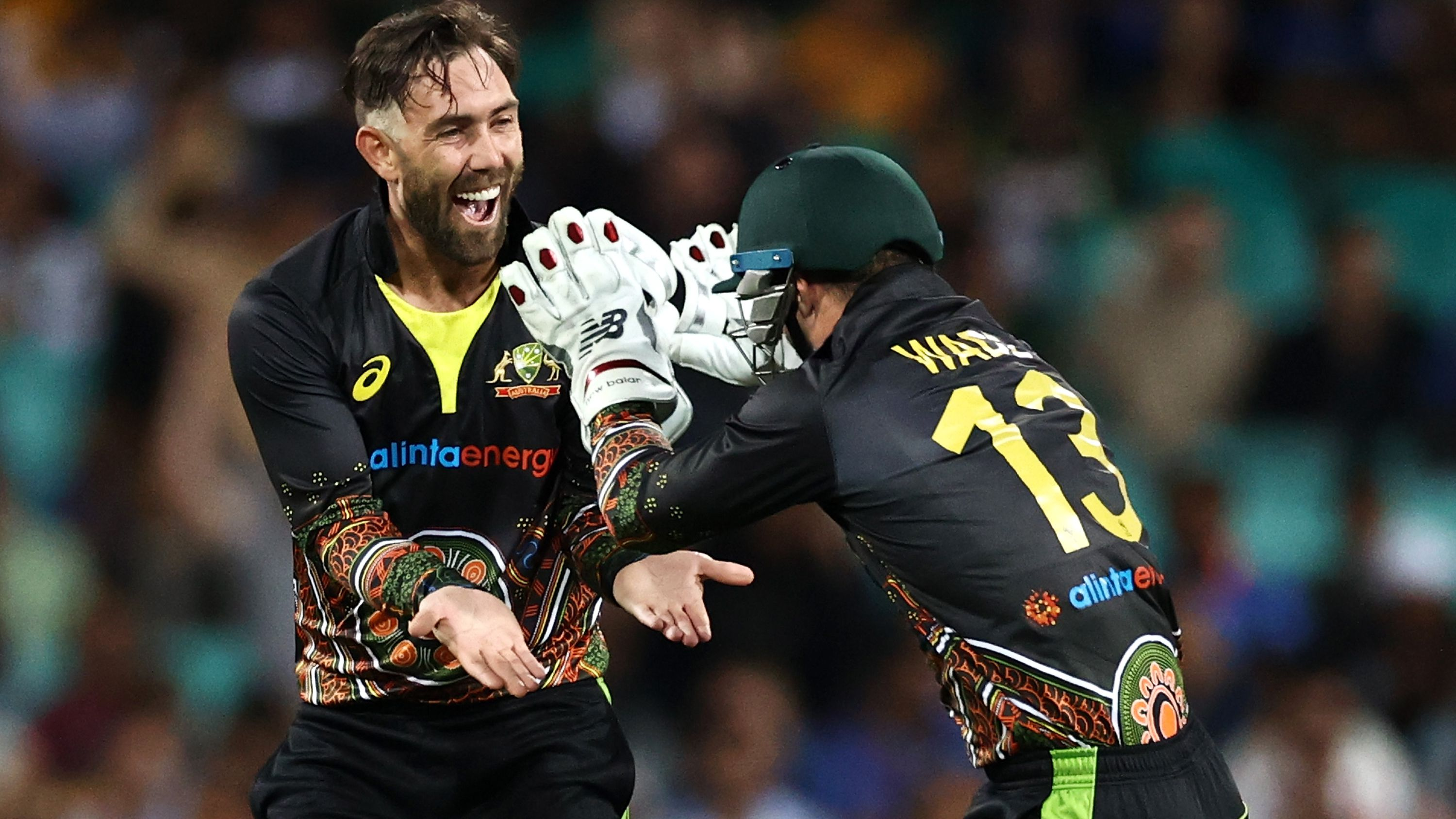 Glenn Maxwell of Australia celebrates with Matthew Wade.