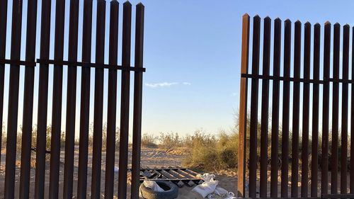 A hole cut in the border fence between Mexico and California, believed to be where the car entered the US.