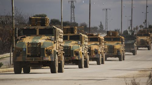 A Turkish military convoy drives in Idlib province.