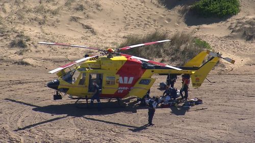 The Westpac Rescue Helicopter arrives at the scene.