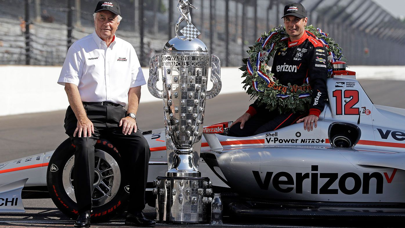 Roger Penske (left) and Will Power with the Indy 500 trophy