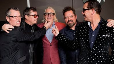 Chris Murphy with INXS band members