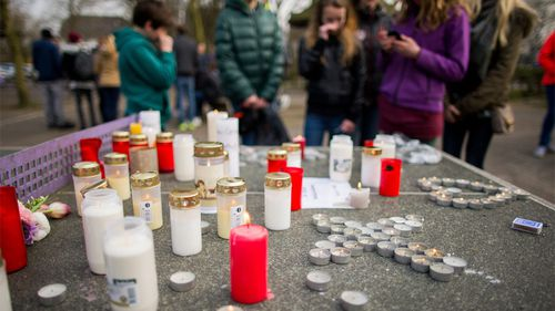 Candles are left outside the college as the children mourn their fellow students. (AAP)