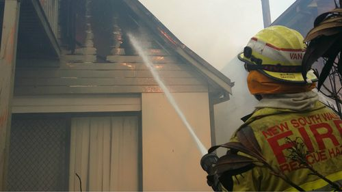 Firefighters battling a blaze at a home in Katoomba.