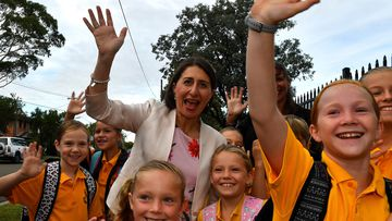 New South Wales Premier Gladys Berejiklian (centre) interacts with students during a visit to Revesby South Public School, in Sydney.