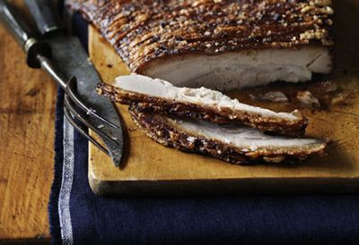Pork belly slow-roasted with harissa and herb rice