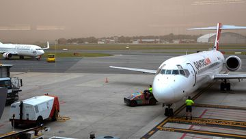 Planes on the tarmac at at Canberra Airport.