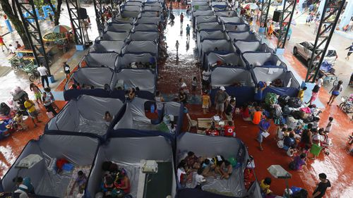 Some 105,000 people were staying in temporary shelters after mass evacuation of coastal areas following major storm surge warnings