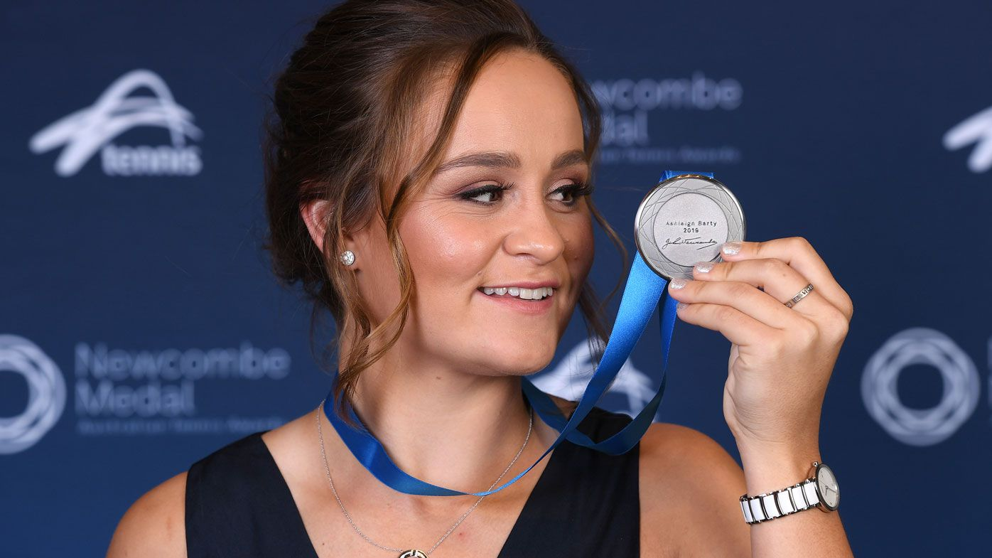 Ashleigh Barty poses with her medal after being awarded the 2019 Newcombe Medal