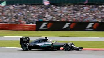 Lewis Hamilton steers his Mercedes on his way to win the British Formula One Grand Prix at the Silverstone racetrack. (AAP)