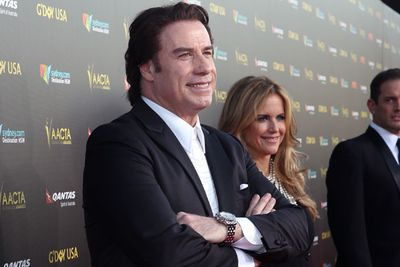 And the most awkward red-carpet pose goes to JOHN TRAVOLTA!