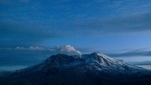 Mount St Helens emits a small, steady cloud of steam at dusk in Washington state. In March, 2005. (Picture: AP)
