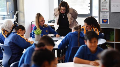 The state's cash-strapped public school are sitting on millions of unspent dollars due to principles feeling over-burdened and cautious to spend the money