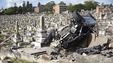 Driver escapes brush with death after cemetery crash