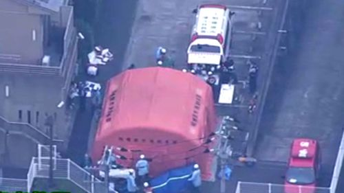 A still image taken from aerial vision purpoting to show the scene outside the centre in Sagamihara. (Image: NHK)