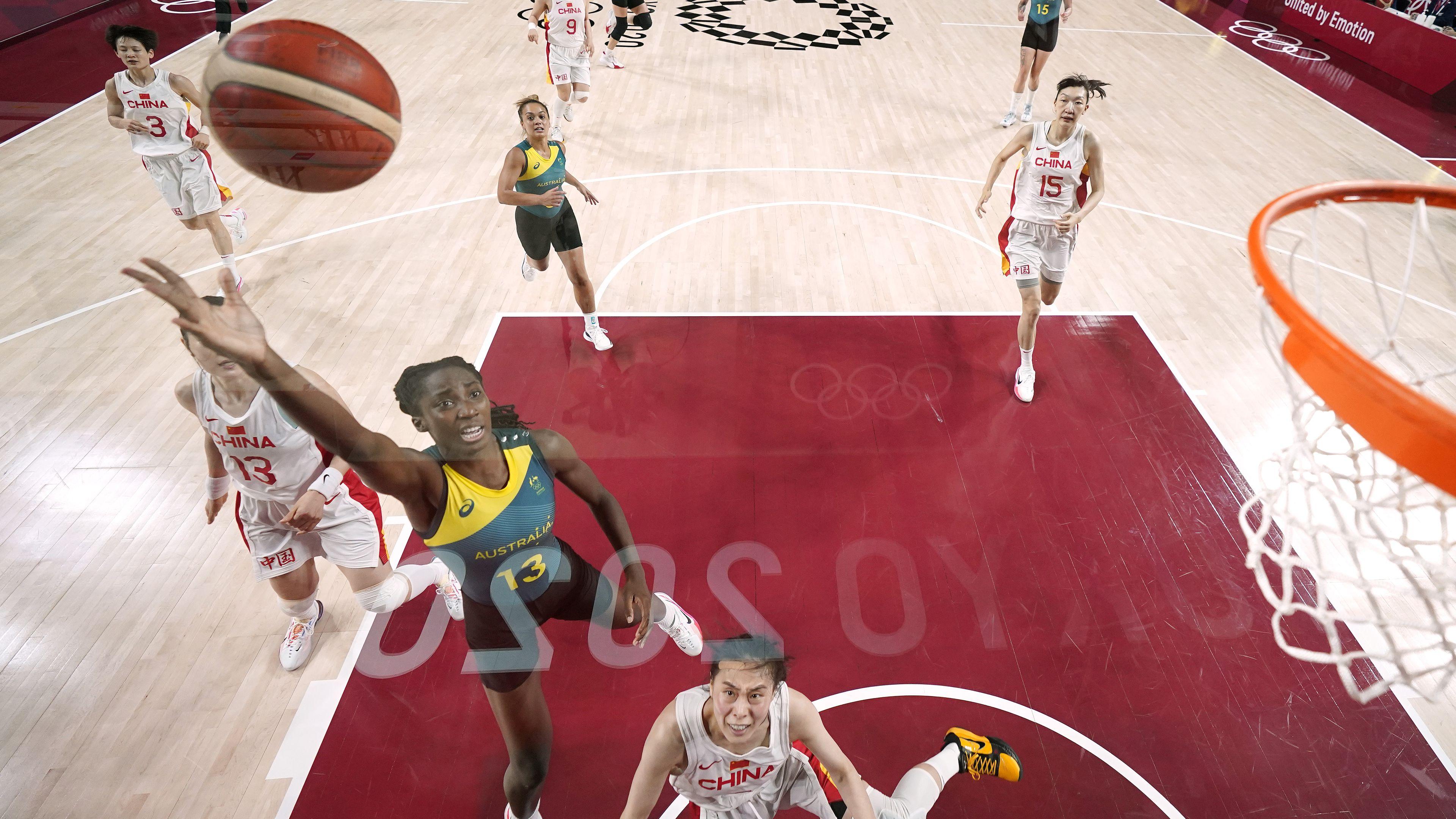 Australia's Ezi Magbegor drives to the basket against China.