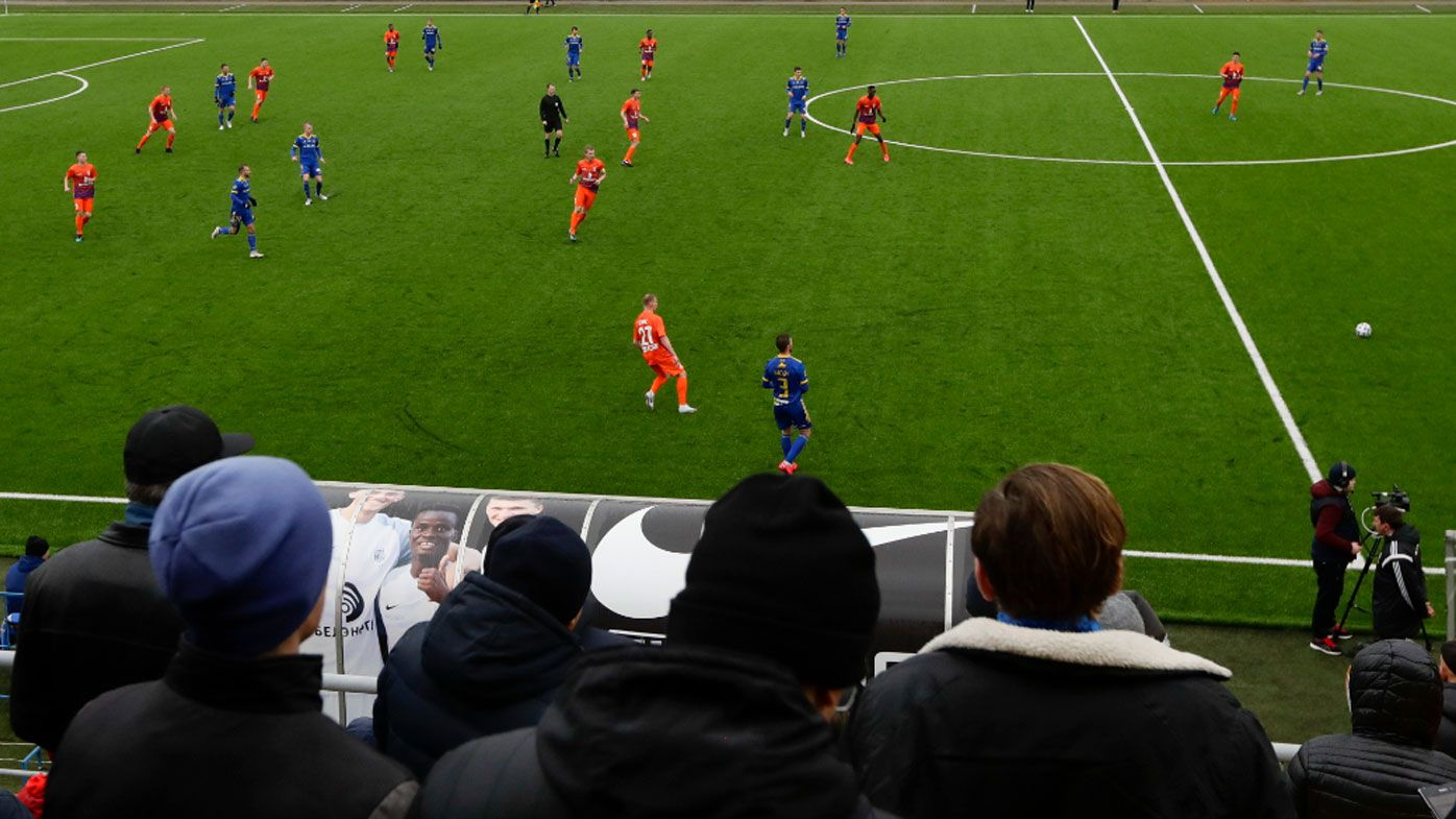 Belarus football league still plays to packed stands despite pandemic