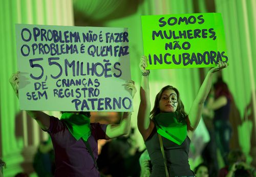 Hundreds of women flooded Rio de Janeiro's streets in Brazil overnight to demand the legalisation of abortion in the country. Picture: AP.