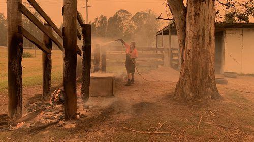Mogo Wildlife park staff member putting out spot fires