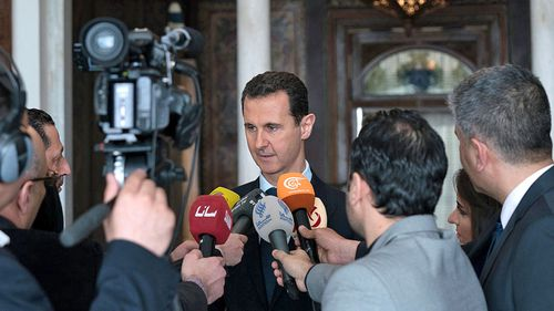 Syrian President Bashar Assad speaks to state media. (AP).