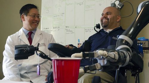 New implant allows brain to move robotic arm