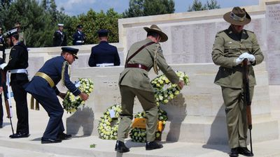Australian Chief of Army Lietutenant-General Angus Campbell (centre) lays a wreath at the Lone Pine Memorial in Gallipoli yesterday. (AAP)