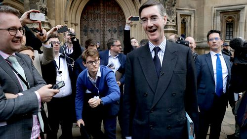 Leading Brexiteer Jacob Rees-Mogg addresses a media scrum after submitting a letter of no confidence in Theresa May.
