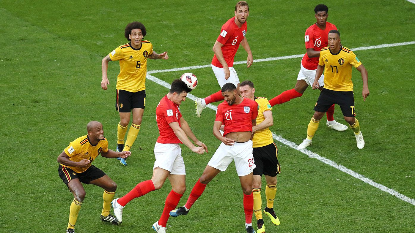 Harry Maguire of England competes for a header in the World Cup third place playoff against Belgium