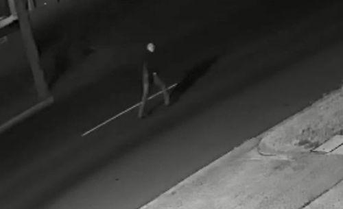The man was captured on camera staggering more than 700 metres down the street, clenching his chest and gesturing to passing cars for help. (9NEWS)