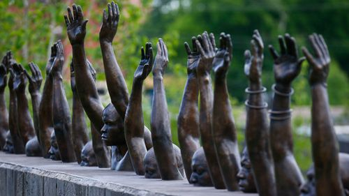 """A bronze statue called """"Raise Up"""" on display at the National Memorial for Peace and Justice. (AP)"""