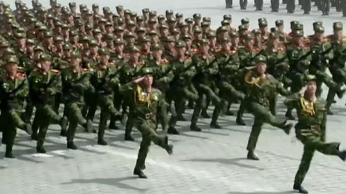 Rows of military bands marched into the vast square. (AFP)