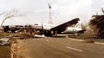 An airliner swept down the road by the powerful winds. (AAP)