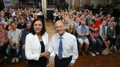 Ms Palaszczuk and Mr Newman pose before the leaders debate. (AAP)