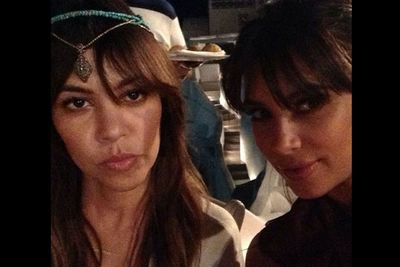 Kourtney pouts while Kim pulls her usual Kim-face. Lighten up, Kourtney! You're on holidays, dear.