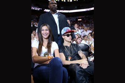 And when Bieber catches a b-ball game, don't think you're getting a VIP seat in the front row for all your efforts. Your job is to stand behind him and block the first few row's view.<br/><br/>Which always goes down real well with die-hard sports fans. <br/><br/>Source: Splash