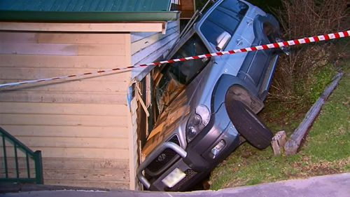Melbourne driver escapes injury after crashing car into own home