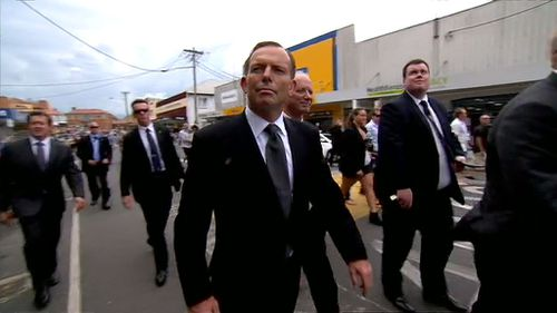 Tony Abbott joined the mourners in the funeral procession. (9NEWS)