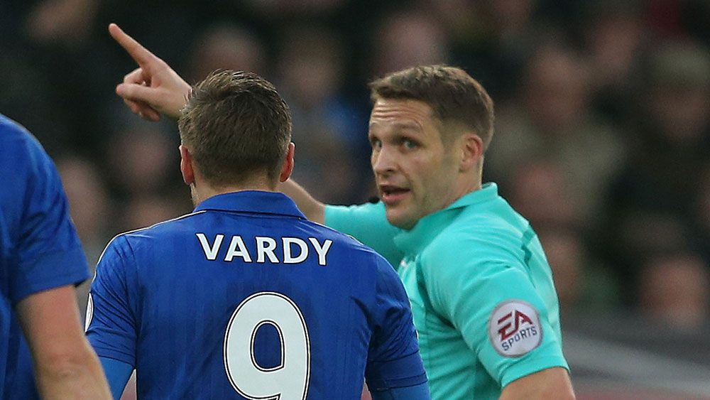 Jamie Vardy is told to leave the field after getting a red card. (AAP)