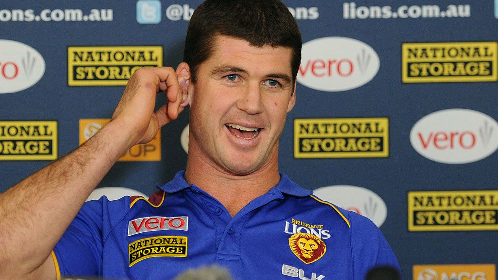 Brisbane Lions great Jonathan Brown has found some of the items he lost in the Queensland floods. (AAP)