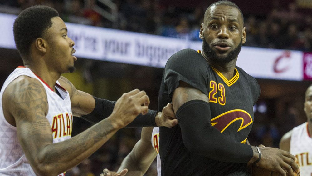 LeBron James and the Cavs suffered their first loss of the season. (AAP)