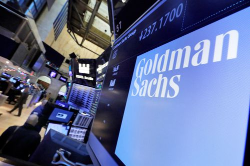 The logo for Goldman Sachs appears above a trading post on the floor of the New York Stock Exchange. (AP Photo/Richard Drew, File)