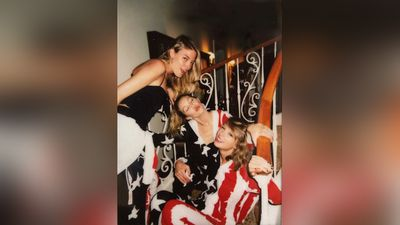 Another shot from Taylor Swift's Fourth of July bash was shared by Gigi Hadid showing herself, Swift and Martha Hunt in star spangled onesies. (Instagram)