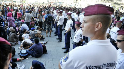 Protests as Budapest closes main train station to migrants