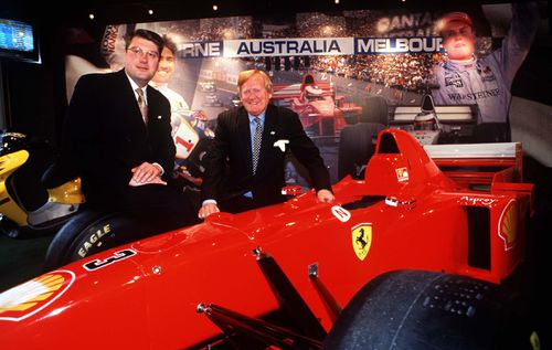 Mr Walker with a Ferrari during the 1999 announcement that Melbourne would host the 2000 Formula One Grand Prix. (Getty)