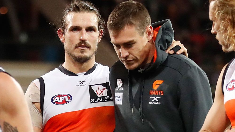 Phil Davis consoles Jeremy Cameron after Thursday night's match in Adelaide. (Getty Images)