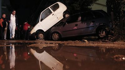 <p>Torrential rain in Athens has turned streets into rivers, uprooted trees and flooded houses and stores.</p><p> The flooding in the ancient city is the result of Hurricane Gonzalo hanging over Europe, which also caused flooding in Italy before it began wreaking havoc across Greece on Friday. </p><p> Up to a dozen households have been left flooded, while up to 30 cars were swept into a pileup after flash-flooding engulfed the streets. </p><p> <i>All images AAP</i></p>