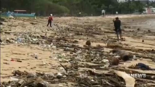 The debris has prompted the closure of beaches in Bali.