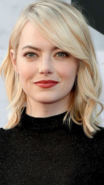 <p>Academy-Award winning actress Emma Stone's romantic side-swept take on a fringe is the perfect hairstyle to turn to if you don't want to commit to a serious bang cut.</p> <p><strong> </strong></p> <p><em>Style Tip</em></p> <p>First create a deep side part in your hair and then section it off to one side. Finish off by pulling your hair into a low pony or a bun and tuck any stray strands behind your ear.</p>