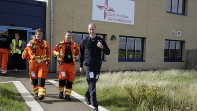 Britain's Prince William, the Duke of Cambridge, centre, starts his final shift with the East Anglian Air Ambulance based out of Marshall Airport, near Cambridge, England, Thursday, July 27, 2017
