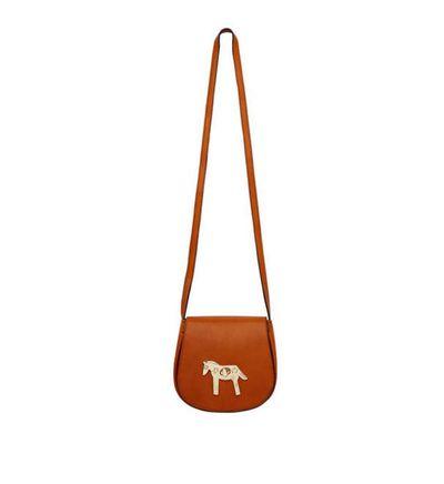 Use this adorable tan handbag with pony clasp as a hip mini bag.